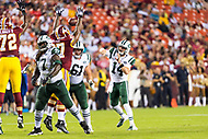 Landover, MD - August 16, 2018: Washington Redskins defensive tackle Tim Settle (97) tips the pass of New York Jets quarterback Sam Darnold (14) during preseason game between the New York Jets and Washington Redskins at FedEx Field in Landover, MD. (Photo by Phillip Peters/Media Images International)