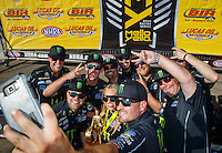 Aug 21, 2016; Brainerd, MN, USA; NHRA top fuel driver Brittany Force (center) poses with her crew members for a selfie as they celebrate after winning the Lucas Oil Nationals at Brainerd International Raceway. Mandatory Credit: Mark J. Rebilas-USA TODAY Sports
