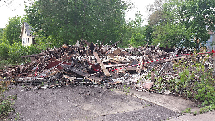 WATERBURY, CT - May 18, 2015, 05182015LX02 - A three story abandoned house at 223 Orange St. was torn down after a suspicious fire made it unsafe on Monday.