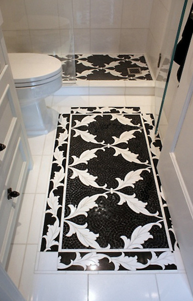 This custom bathroom features a Tamara mosaic rug and custom Tamara border shown in honed Nero Marquina and polished Thassos from the Silk Road Collection by Sara Baldwin for New Ravenna.<br />