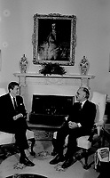 Washington, DC., USA, February 13, 1984<br />President Ronald Reagan meets with King Hussein II of Jordan in the Oval Office of the White House. Credit: Mark Reinstein/MediaPunch