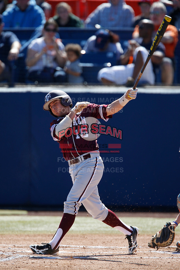 Mikey Reynolds #16 of the Texas A&M Aggies bats against the Cal State Fullerton Titans at Goodwin Field on March 10, 2013 in Fullerton, California. (Larry Goren/Four Seam Images)