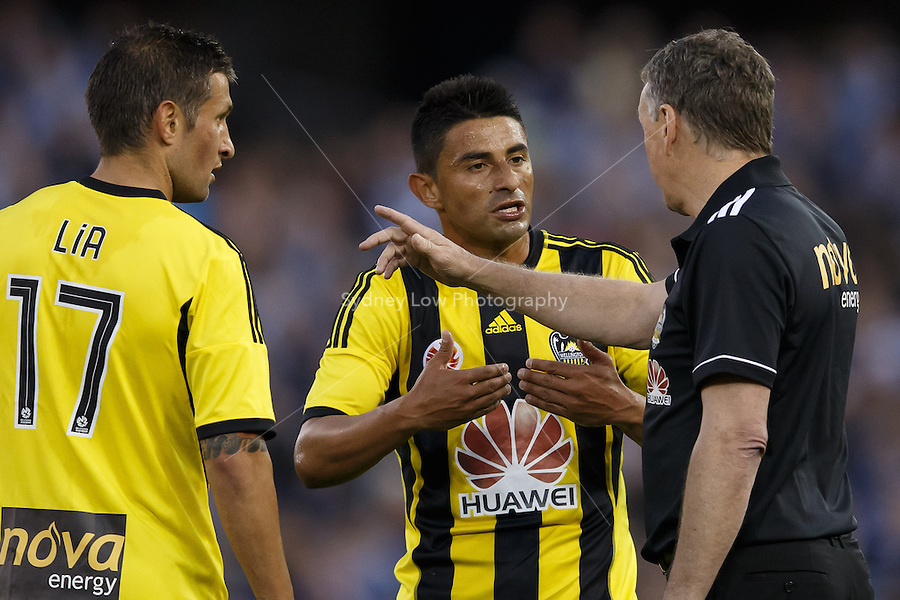 Carlos HERNADEZ of the Phoenix in discussion with his coach Ernie MERRICK in the round four match between Melbourne Victory and Wellington Phoenix in the Australian Hyundai A-League 2013-24 season at Etihad Stadium, Melbourne, Australia.<br /> This image is not for sale. Please visit zumapress.com for image licensing.