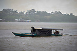 A floating dental clinic motors along the Javari River at Atalaia do Norte in Brazil's Amazon region.