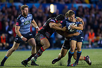 Jarrod Evans of Cardiff Blues is challenged by Junior Rasolea and Stuart McInally of Edinburgh during the Guinness PRO14 match between Cardiff Blues and Edinburgh Rugby at BT Sport Cardiff Arms Park, Cardiff, Wales on 1 September 2017. Photo by Mark  Hawkins.