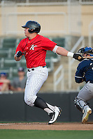 Corey Zangari (14) of the Kannapolis Intimidators follows through on his swing against the Asheville Tourists at Kannapolis Intimidators Stadium on May 26, 2016 in Kannapolis, North Carolina.  The Tourists defeated the Intimidators 9-6 in 11 innings.  (Brian Westerholt/Four Seam Images)
