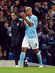 Vincent Kompany of Manchester City applauds the crowd as he goes off injured during the UEFA Champions League match at the Etihad Stadium. Photo credit should read: Philip Oldham/Sportimage
