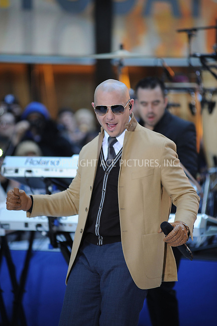 WWW.ACEPIXS.COM . . . . . .November 21, 2012...New York City...Pitbull performs on NBC's 'Today' at Rockefeller Center on November 21, 2012 in New York City.....Please byline: KRISTIN CALLAHAN - ACEPIXS.COM.. . . . . . ..Ace Pictures, Inc: ..tel: (212) 243 8787 or (646) 769 0430..e-mail: info@acepixs.com..web: http://www.acepixs.com .