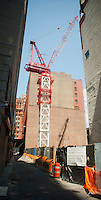 A construction crane at a development site in Lower Manhattan, seen on Sunday, July 22, 2012 (© Richard B. Levine)