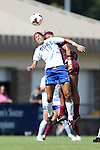 29 September 2013: Duke's Kim DeCesare (19) and Virginia Tech's Candace Cephers (behind) challenge for a header. The Duke University Blue Devils hosted the Virginia Tech University Hokies at Koskinen Stadium in Durham, NC in a 2013 NCAA Division I Women's Soccer match. The game ended in a 1-1 tie after two overtimes.