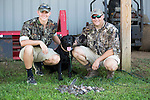 Todd and Caleb Johnson with Abby at Sodworks annual dove hunt 2014, Friday Sept. 5, 2014  in Lexington, Ky. Photo by Mark Mahan