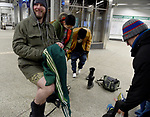 (Boston MA 01/07/18) Nathan Proctor of Quincy, smiles as a passersby makes a comment about his legs, as participants in the event remove their pants, during the annual no pants subway ride, Sunday, January 7, 2018, in Boston. This is an annual global event started in New York in 2002. The brief ride through several lines lasted about 90 minutes and was smaller in numbers compared to the previous years organizers attributing that to the bone chilling weather. Herald Photo by Jim Michaud