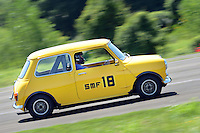 Jon Clerk of Chalfont, Pennsylvania races his 1967 Mini Cooper, which he restored himself, around the track during his first run during the 2016 Annual Holbert Memorial Philly SCCA (Sports Car Club of America) autocross Sunday July 17, 2016 in Warminster, Pennsylvania. Members get three runs around a closed track with their fastest times counting for their finish position. The group holds races at Warminster about 6 times per year as well as other places around the Philadelphia region. (Photo by William Thomas Cain)