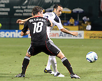Devon McTavish #18 of D.C. United holds up Landon Donavon #10 of the Los Angeles Galaxy during an MLS match at RFK Stadium on July 18 2010, in Washington D.C. Galaxy won 2-1.