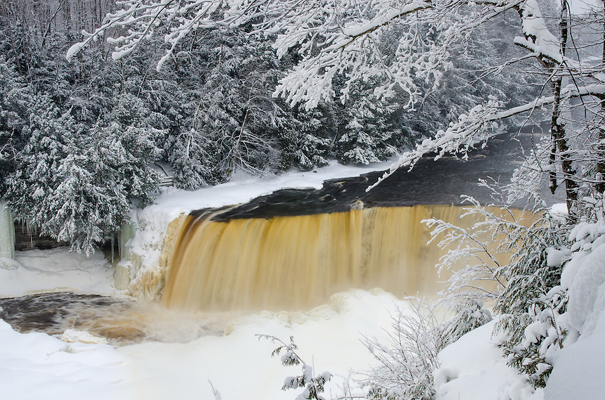An early morning winter at Tahquamenon Falls. Fresh snow and mist rising from the falls made for an impressive sight.