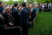 United States President Barack Obama shakes hands with members of the audience following remarks at an Earth Day reception in the Rose Garden at the White House in Washington, D.C., U.S., on Thursday, April 22, 2010. .Credit: Brendan Hoffman - Pool via CNP