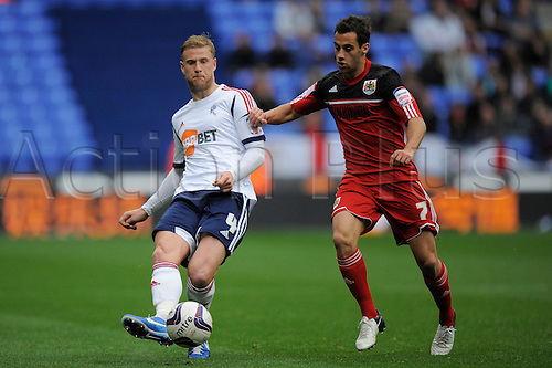 20.10.2012 Bolton, England.Matthew Mills of Bolton and Liam Fontaine of Bristol City   in action during the Championship game between Bolton Wanderers and Bristol City from the Reebok Stadium.