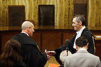 Milano:  il pubblico ministero Fabio De Pasquale stringe la mano all'avvocato Ghedini dopo la lettura della sentenza del processo Mills. Il reato è stato prescritto per decadenza dei termini...Milan: Prosecutor Fabio De Pasquale (left) shakes hands with Niccolo' Ghedini (lawyer of Berlusconi) after the reading of the verdict for the case where the former Italian Prime Minister Silvio Berlusconi stands accused of bribing British lawyer David Mills waits the reading of the verdict in a case where Silvio Berlusconi was accused of bribing British lawyer David Mills..The court has ruled that the statute of limitations has run out in the corruption case against Silvio Berlusconi