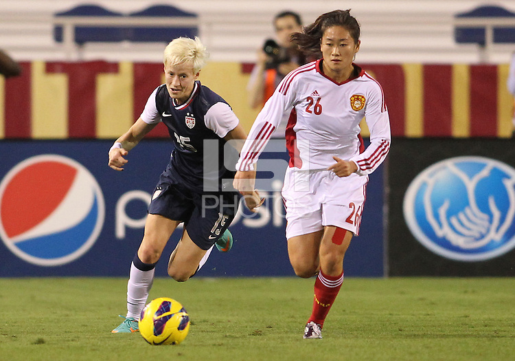 BOCA RATON, FL - DECEMBER 15, 2012: Megan Rapinoe (15) of the USA WNT chases after Wu Haiyan (26) of China WNT during an international friendly match at FAU Stadium, in Boca Raton, Florida, on Saturday, December 15, 2012. USA won 4-1.
