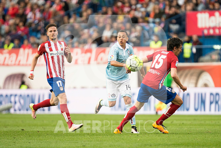 Atletico de Madrid's Saul and Savic and Celta de Vigo's Orellana during La Liga Match at Vicente Calderon Stadium in Madrid. May 14, 2016. (ALTERPHOTOS/BorjaB.Hojas)