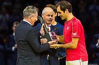 27th October 2019; St. Jakobshalle, Basel, Switzerland; ATP World Tour Tennis, Swiss Indoors Final; Roger Federer (SUI) receives the commemorative trophy for his tenth Swiss Indoors win from Deputy Tournament Director Daniel Chambon and Tournament Managing director Patrick Ammann after the match against Alex de Minaur (AUS) - Editorial Use
