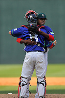 Pitcher Anyelo Leclerc (36) of the Greenville Drive his catcher Austin Rei after a win in a game against the Asheville Tourists on Sunday, April 10, 2016, at Fluor Field at the West End in Greenville, South Carolina. Greenville won 7-4. (Tom Priddy/Four Seam Images)