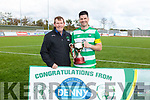 Killarney Celtic's captain John McDonagh accepts the Greyhound Cup from Sean O'Kefee (Chairman KDL) overcoming Tralee Dynamos in the Greyhound Bar KO Cup final on Sunday.