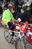 10 JUN 2011 - BRANSGORE, GBR - Quintuple Enduroman competitor Ian Walsh is fed by his supporter, girlfriend Leanne Carberry, whilst taking a break during the Enduroman Ultra Triathlon Championships .(PHOTO (C) NIGEL FARROW)