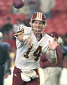 Washington Redskins quarterback Brad Johnson (14) throws a pass during warm-ups prior to the game against the Tennessee Titans at FedEx Field in Landover, Maryland on October 30, 2000.The Redskins lost the game 27 - 21.<br /> Credit: Arnie Sachs / CNP