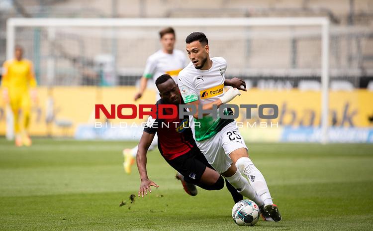 Ramy Bensebaini (Bor. Moenchengladbach) im Zweikampf.<br /><br />27.06.2020, Fussball, 1. Bundesliga, Saison 2019/20, 34. Spieltag, Borussia Moenchengladbach - Hertha BSC Berlin, <br /><br />Foto: MORITZ MUELLER/POOL/via/Meuter/Nordphoto<br />Only for Editorial use