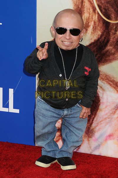 Verne Troyer.World premiere of 'Jack & Jill' at Mann Village Theatre in West Hollywood, California, USA..November 6th, 2011.full length black top grey gray cardigan sunglasses shades jeans denim hand v peace sign.CAP/ADM/BP.©Byron Purvis/AdMedia/Capital Pictures.