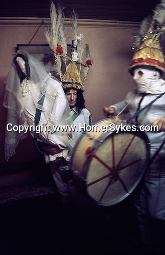 Biddy Boys 1970s. Killorglin  Co Kerry Ireland. February 2nd festival to celebrate the Celtic Saint Bridgid. A large doll and effegiecy of St Bridgid is taken from house to house, Money is either given to the Biddy Boys or a pin- safty pin- is fixed to rge dill as a symbol of good luck.