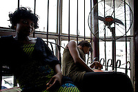 """Two customers wait for their hair to be styled at the """"Downtown beauty salon"""" where several Nollywood stars frequently have their hair styled by head hair dresser Agnes Adamson and her staff in Lagos, Nigeria on Friday March 27 2009..Currently the most requested hair styles at the salon are """"Take a bow"""" and Crazy Alia""""...Currently, Nigerian films outsell Hollywood films in Nigeria and many other African countries..Nollywood is a nascent film industry in Nigeria, growing up within the last two decades to become the third largest film industry on the planet, behind the United States and Indian film industries. Nigeria has a US$250 million movie industry, churning out some 200 videos for the home video market every month."""