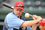 Manager Mickey Morandini (12) of the Lakewood BlueClaws hits in an infield drill prior to a game against the Greenville Drive on Wednesday, April 24, 2013, at Fluor Field at the West End in Greenville, South Carolina. Lakewood won, 7-5. (Tom Priddy/Four Seam Images)