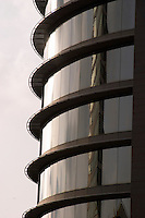 Reflections in curved facade of office building. Barcelona, Catalonia, Spain.