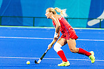 Kelsey Kolojejchick #7 of United States looks for a pass upfield during USA vs Japan in a Pool B game at the Rio 2016 Olympics at the Olympic Hockey Centre in Rio de Janeiro, Brazil.