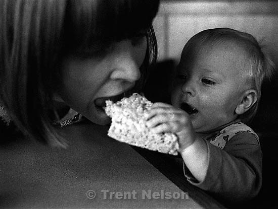 Noah Nelson feeds Laura Nelson a marshmallow treat, Fuddrucker's, october 1996.<br />