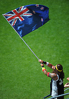 A fan flies the NZ flag on day two of the 2016 HSBC Wellington Sevens at Westpac Stadium, Wellington, New Zealand on Sunday, 31 January 2016. Photo: Dave Lintott / lintottphoto.co.nz