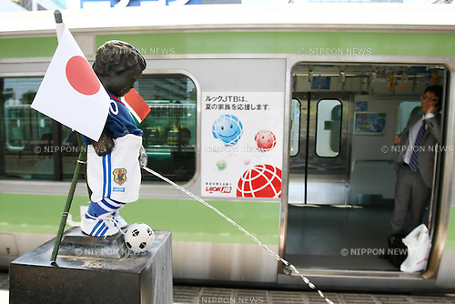 "June 1, 2010 - Tokyo, Japan - Peeing Boy ""Shoben Kozo"" wearing Japan National Soccer Team suit is pictured at Hamamatsucho station in Tokyo, Japan, on June 1, 2010. A volunteer group makes clothes and dresses up in seasonal outfits the bronze statue installed in the station since 1968. The Japan national football team, nicknamed Samurai Blue, will start 2010 FIFA World Cup South Africa tournament against Cameroon, on June 14."