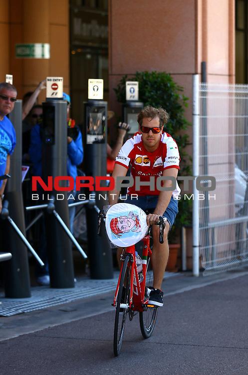 23. bis 25.05.2015, Circuit de Monaco, Monte Carlo, MCO, Gro&szlig;er Preis von Monaco, Monte Carlo, im Bild   Sebastian Vettel (GER), Scuderia Ferrari auf dem Fahrrad<br />  Foto &copy; nph / Mathis