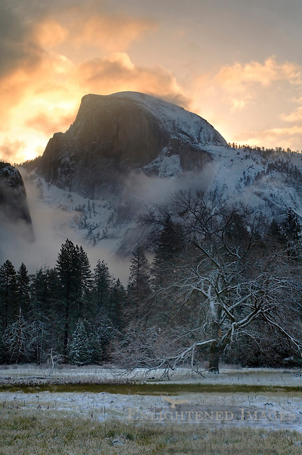 Storm clouds at sunrise and fresh snow in meadow below Half Dome, Yosemite Valley, Yosemite National Park, California
