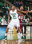 North Texas Mean Green forward Alonzo Edwards (34) and Troy Trojans forward Tim Owens (42) in action during the game between the Troy Trojans and the University of North Texas Mean Green at the North Texas Coliseum,the Super Pit, in Denton, Texas. UNT defeats Troy 87 to 65.....