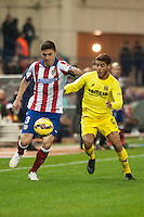 Atletico de Madrid´s Siqueira and Villarreal´s Jonathan Dos Santos during 2014-15 La Liga match between Atletico de Madrid and Villarreal at Vicente Calderon stadium in Madrid, Spain. December 14, 2014. (ALTERPHOTOS/Luis Fernandez) /NortePhoto