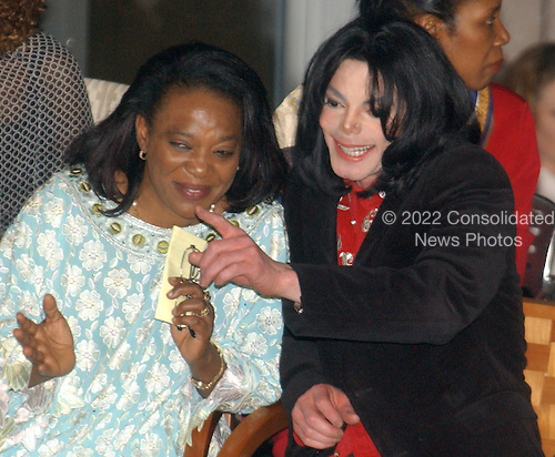 Recording Superstar Michael Jackson points out one of the young performers to Haoua Diatta, wife of Nigerian Ambassador Diatta during the award ceremony at the Embassy of Ethiopia in  Washington, D.C. on April 1, 2004.  He was honored there for his worldwide humanitarian efforts, particularly in Africa.  His charitable contributions have been in excess of 50 million US dollars worldwide during his lifetime..Credit: Ron Sachs / CNP
