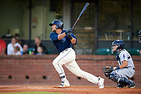 Mobile BayBears designated hitter Jose Briceno (35) follows through on a swing in front of catcher Adrian Nieto (17) during a game against the Pensacola Blue Wahoos on April 25, 2017 at Hank Aaron Stadium in Mobile, Alabama.  Mobile defeated Pensacola 3-0.  (Mike Janes/Four Seam Images)