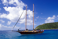 Jost Van Dyke, British Virgin Islands, Caribbean, BVI, Sailboat anchored in Great Harbor off of Jost Van Dyke Island on the Caribbean Sea.