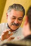 Mature men playing cards, close-up