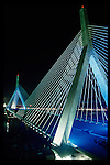 The Leonard P. Zakim Bunker Hill Memorial Bridge is the widest cable stay bridge in the world; it carries ten lanes of traffic.  The bridge is in Boston Massachusetts, USA, and was part of the Big Dig, the largest highway construction project in the US.  The bridge is shown here near completion, in 2003.  Photo by Gus Curtis.