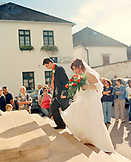 AUSTRIA, Rust, a young couple enters a church in Rust to be married, Burgenland