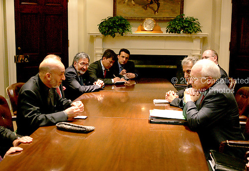 Washington, DC - June 15, 2004 -- United States Vice President Dick Cheney meets with President Hamid Karzai of Afghanistan in the Roosevelt Room at the White House in Washington, D.C. on June 15, 2004. .Credit: David Bohrer / White House via CNP